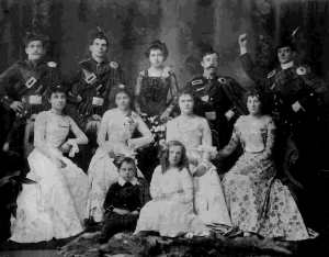 Elizabeth Holt second from left with James Parkinson behind her and little sister May sitting on floor - taken September 8 1902 at the Albert Hall Wakatipu Ball possibly hosted by her father John Holt.