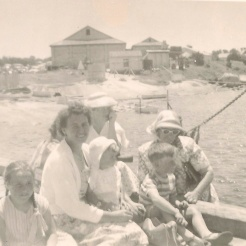 Aunt Dorrie with hat on over the edge of the Lady Barron wharf. Dorothy nursing moi!!