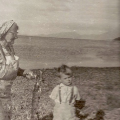 Doris with grandson - a good photo, possibly around from Big Badger Corner, may Watering beach area.